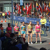 On Sunday morning we went to watch the Invitational Mile race.  It was 3 laps around the block and finished at the marathon finish line.  Here are the elite women.  Carrie Tollefson is 2nd from the right.  You've probably seen her in Runner's World.
