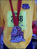 """This is what I want next year. Its over 7"""" tall and 6"""" wide, weighs in at 2.5 POUNDS! It gets bigger each year so they remain the worlds largest finisher marathon medal"""