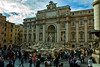 A full view of the Trevi Fountain and the gaggle therein.