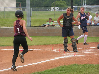 PICT4138Chelsea Eube  scored a run against the lady metros 8-15