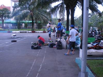 Saigon - Door to Door Fermented Yogart Advertisers - Race cars in Park