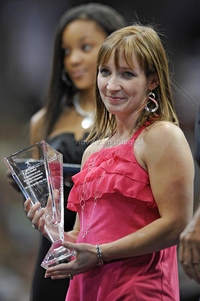 2009 Visa Championship:  Women's Competition (Aug. 12th - 15th) <br /> Kim Zmeskai  (1992 Barcelona Bronze Medalist) receives an appreciation award for contributing to gymnastics at the American Airlines Center in Dallas, Texas.