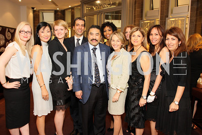 Robert Hisaoka and the staff of the Tyson's Galleria Cartier. Photograph by Tony Powell