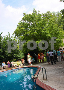 Michelle Fenty and Jamaican Ambassador Anthony Johnson host a poolside reception to benefit the Jamaican Women of Washington 2009 Charity recipients, Photograph by Tony Powell