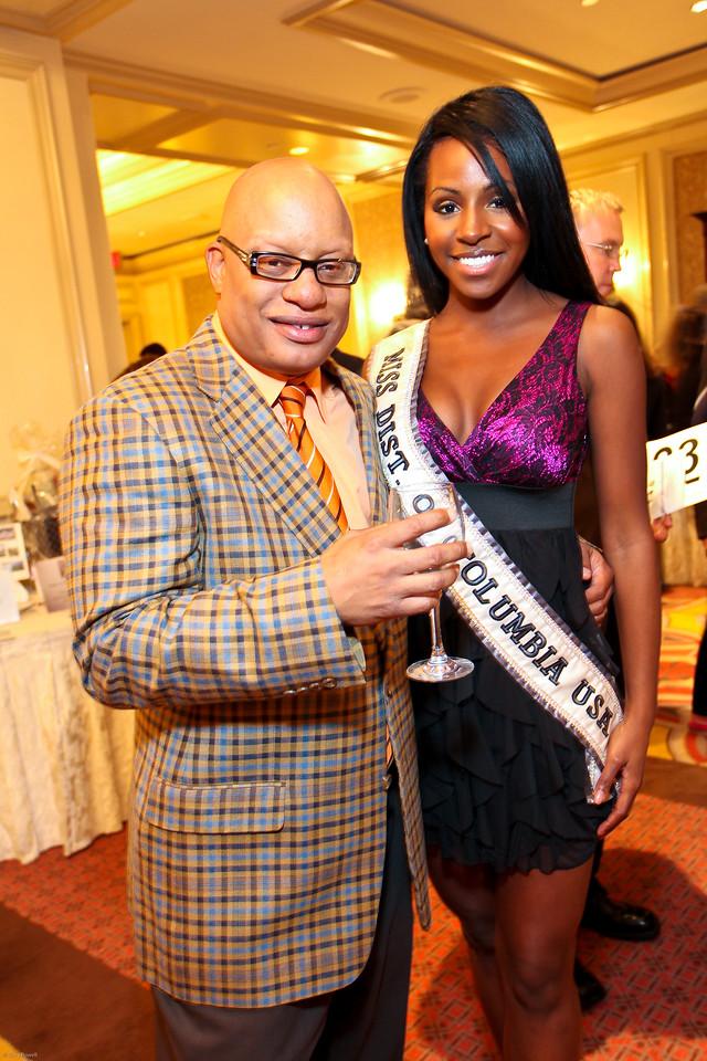 Recording Artist Ski Johnson and Miss DC USA Nicole White. March of Dimes Signature Chefs Auction of DC. Ritz Carlton Ballroom. November 2, 2009. photos by Tony Powell