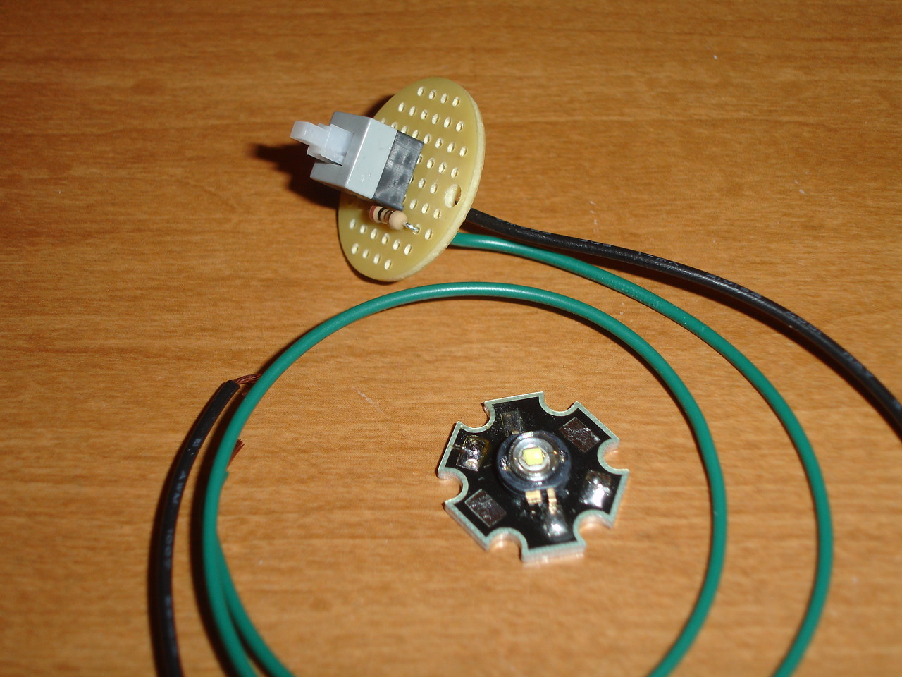 The electronics bits -- Luxeon 1 Watt LED on heatsink, tailcap clicky switch with 10 resistor