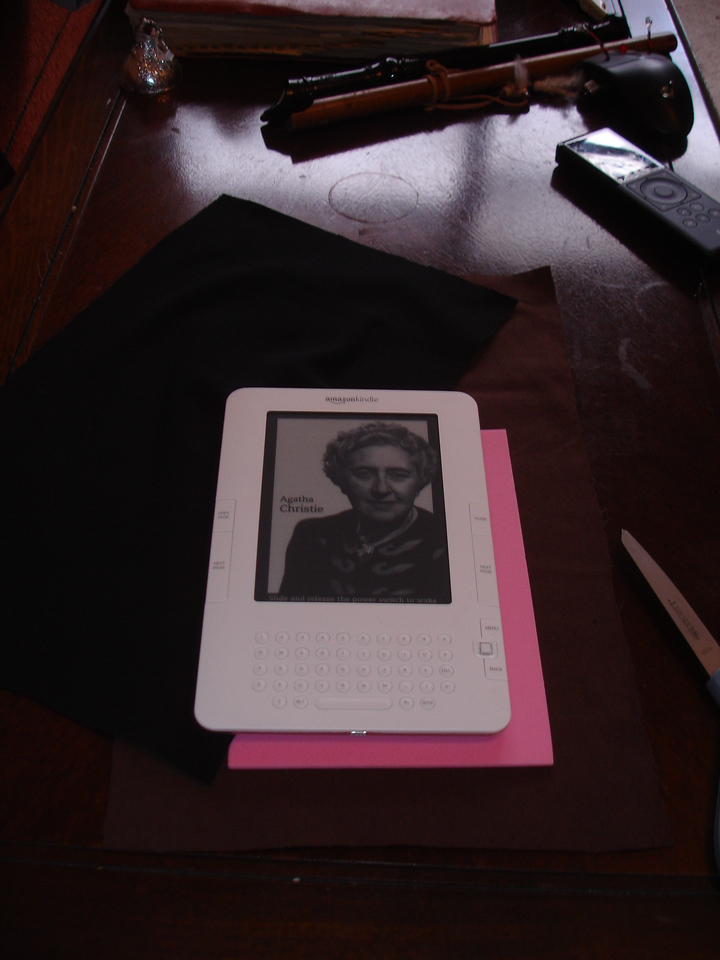 """Making a slip cover for my new Kindle using brown canvas for the outside, black """"jersey fabric"""" for the inside, and a layer of 3mm foam (pink, of course) to provide some screen protection"""