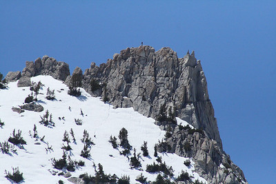A climber atop Unicorn Peak. From Elizabeth Lake we watched him and a buddy zig-zag up through the snow and emerge from the other side. Taken with my telephoto lens.