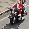 Santa (Howard Bristow) and Mrs. Claus (Georgette Payne) lead the riders along South Main Street in Attleboro as the Blackstone Valley Harley Owners Group held its annual to benefit the Christmas Is For Kids Ride heads up South Main Street in Attleboro. The HOGS later gathered at the North Attleboro Elks. (Staff photo by Tom Maguire)