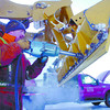 Citizen photo by David Mah Roy Roe, of Lobol Enterprises LTD, changes blade edges of a front end loader in the Prince George Exhibition grounds. Snow clearing resumed in the minus 25 weather Friday morning.