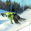 Citizen photo by David Mah Brett Reimer, 17, angles into a turn in the fresh snow at Hart Highlands Ski Hill. A few boarders and skiers braved the minus 25 temperture Friday.