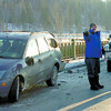 Citizen photo by David Mah An RCMP Constable speaks to a driver of a vehicle invovled in a multi-vehicle accident on the Simon Fraser Bridge Friday morning. There were no serious injuries. Traffic had to alternate until the vehicles were moved.