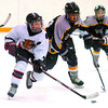 Citizen photo by David Mah Freightliner PeeWee Cougar Steven Jandryk, looks for a teamate as he and Dryden Downing, of Williams Lake race for the puck.