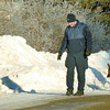 Citizen photo by Brent Braaten RCMP track a suspect in a break and enter in the Hart along Dawson road Monday morning. Police were unable to pick up the track.