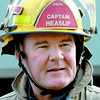Citizen photo by Brent Braaten Captain John Heaslip speaks to media outside the scene of a basment fire at city Furniture on Third Avenue.
