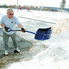 Citizen photo by Brent Braaten Bill Neilson clears the ice of his driveway at his Oak Street home Tuesday morning. he wanted to get the ice off while the tempertures are warm.