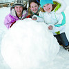 Citizen photo by Brent Braaten Westwood Elementary students Jordan Caron, 13, Lexine Hamilton, 12, and ashley Erickson, 12, push a gigantic snowball in the school yard over the lunch break Tuesday.