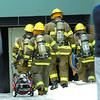 Citizen photo by Brent Braaten City of Prince George fire fighters go into the basment of City Furniture off of Brunswick Street Tuesday. The fire department  responded at 12:35 p.m.  when they arrived they found smoke in the basement and three or four sprinkler heads had gone off. They found a small fire in some pallets and piled cardboard and quickly put it out. Then they vented out the smoke and dealt with the 3 to 4 inches of water in the basement.