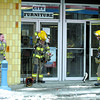 Citizen photo by Brent Braaten City of Prince George fire fighters stage outside of City Furniture on Third avenue Tuesday. The fire department  responded at 12:35 p.m.  when they arrived they found smoke in the basement and three or four sprinkler heads had gone off. They found a small fire in some pallets and piled cardboard and quickly put it out. Then they vented out the smoke and dealt with the 3 to 4 inches of water in the basement.