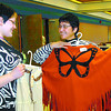 Marianne Walker, left, and Gloria George, try out a cape made of cashmere at the Dancing Loon Cree-ations booth, which was one of the vendors at the Urban Aboriginal Open-Space Gathering held at the Civic Centre Wednesday and Thursday. Citizen photo by David Mah