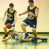 College Heights Adam Starzyk hits the ground and losses the ball between Nechako Valley players Zach Killam, left, and Cam Reid, right during the first half game at D.P. Tod Secondary. Citizen photo by Brent Braaten
