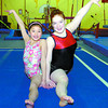 Prince George Gymnasts Lina Goto, 11, left, and Storm Garcia, 15, are going to Western Canadian Championships. Citizen photo by David Mah