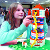 Adelene Ginter, 11, puts the final touches on her Lego entry titled Rapunzel, in the 6th Annual LegoExtravaganze at the Prince George Public Library Saturday. The event had 60 entrants. Ginter won the age 11 - 12 category. Citizen p[hoto by David Mah