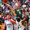 UNBC Timberwolf Paul Burkholder soars over #15, Denis Dervisevic, left, and #5, Marlon Campbell, of the Algonquin Thundaer in the bronze medal game. Citizen photo by David Mah