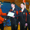 RCMP Cst. Brian Merriman presents RCMP Youth Academy graduate Derrick Brignall, from Prince George with his certificate of completion. Brandon Jennings, from Prince George, Christina Vanderkwaak, from Smithers, and 26 other students completed the 7th annual North District  RCMP Youth Academy depot simulator course. Students from as far as 100 Mile House and the Yukon took part in the week-long course. Citizen photo by David Mah