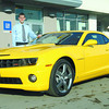 Corey Petrie from Wood Wheaton Chevrolet Cadillac with 2010 Chevrolet Camaro SS. Citizen photo by Brent Braaten
