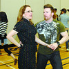 Tessa Cunningham and Myles Munroe, Canada's top West coast Swing couple, teach the dance to Grade 9 students at PGSS Wednesday morning. Citizen photo by Brent Braaten