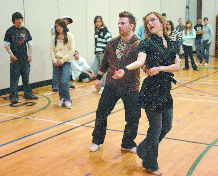 Myles Munroe and Tessa Cunningham, Canada's top West coast Swing couple, teach the dance to Grade 9 students at PGSS Wednesday morning. Citizen photo by Brent Braaten