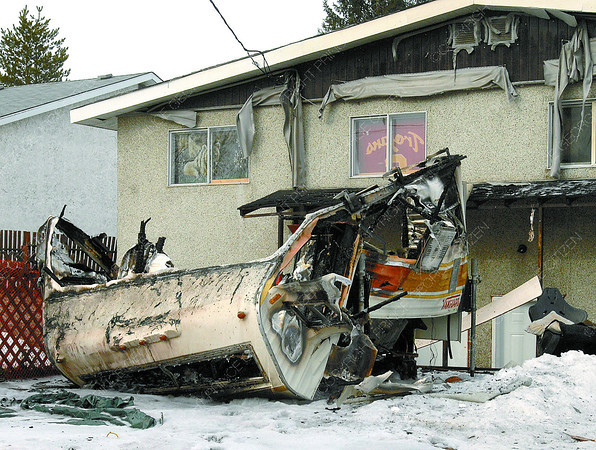 A camper that was destroyed by fire Thursday morning in the backyard of a duplex at Strathcona Avenue and Oak Street. Citizen photo by Brent Braaten