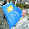 Mayor Dan Rogers and Canadian Cancer Society regional manager Margaret Jones-Bricker with the Canadian cancer society flag that will be flown at City Hall to launch the society's annual spring fundraising drive.  Citizen photo by Brent Braaten