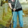 Alyson Graham, was into the spring cleaning as she raked the gardens around the Spruce Manor on Juniper Street. Citizen photo by David Mah