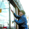 Eighty-seven-year-old Bill Angus makes sure the windows of the Carson Insurance building on Victoria Street are clean for customers and employees.  Citizen photo by David Mah