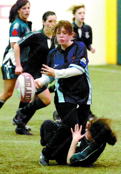 Amber Sheppard, from Kelley road gets a pass away while being taken down by a PGSS player during rugby practice in the Charles Jago Northern Sport Centre. Citizen photo by David Mah.
