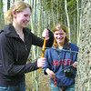 Heather Heim, left, from Prince George, and Nina Buchholz, from Edmonton, Alberta, take a core sample from a douglas fir during a exercise in the Yellowhead Rotary Adventure in Forestry tour at UNBC. 20 sponsored high school students from France, Spain, and western Canada, gathered here to learn about CNC, UNBC, and apprenticeship in natural resources in a 3-day introductory course. Citizen photo by David Mah