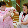 Bette Marshall, left, and Jeannie Tasa have fun making sundae's in the lobby of PGRH Friday afternoon. The Auxillary to PGRH were celebrating Health Care Auxiliary Day in B.C. with sundae's, coffee and free draws for prizes. Citizen photo by Brent Braaten