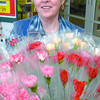 Bev Dunaway with carnations at Wal-Mart for the 33rd annual Carnation Campaign by the Multiple Sclerosis Society. The carnations being sold for a donation will be at various location around prince George until Sunday. Citizen photo by Brent Braaten