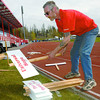 Dave Hewitt, Relay for life committee member, organizes the team signs at Masich Place stadium in preperation for the Relay for Life that starts at 10 am Saturday morning. Citizen photo by Brent Braaten