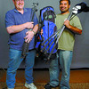Lance Brommeland, executive with Prince George Senior Baseball, left, and Ram Sandhu, winner of the Citizen Hockey Challenge, show the TNT golf clubs and bag from the Laurie Pierce Golf Shop at the Prince George Golf and Curling Club. Citizen photo by David Mah