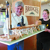 Prince George Railway and Forestry Museum curator James Tirrul-Jones, and summer student Michelle Henry move a model of the temporary Fraser River bridge at South Fort George built in 1914. The model was built by Roy Groeneveld. The model is part of the Bridges progressive exhibit which can be seen on opening day today. Citizen photo by David Mah