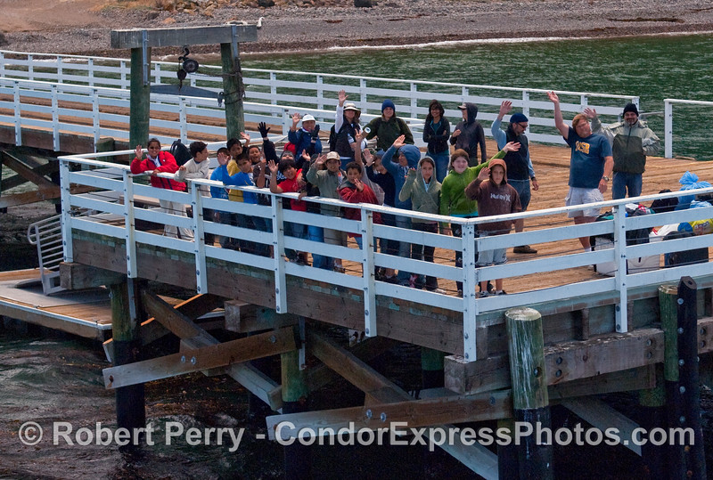Santa Cruz Island campers prepare to leave the pier and board the Condor Express - Prisoner's Harbor.