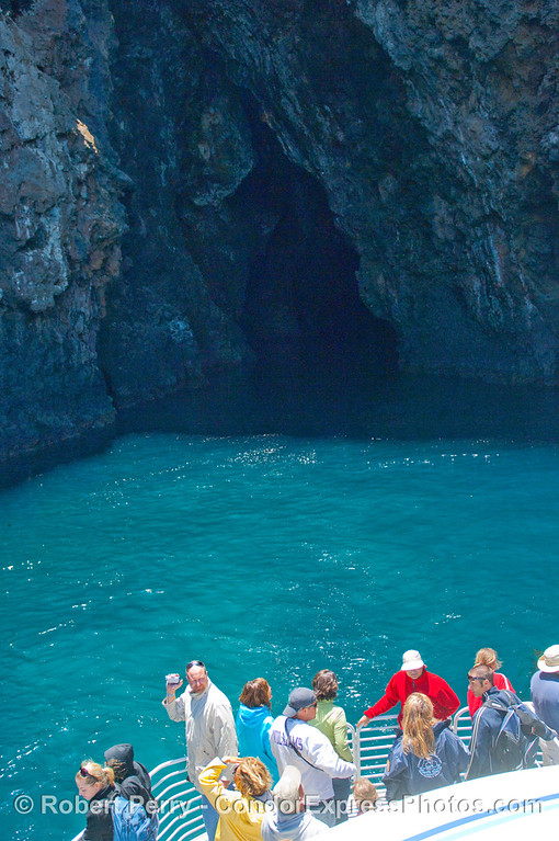 Passengers on the bow of the Condor Express prepare to enter the world famous Painted Cave on Santa Cruz Island.