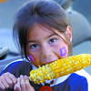 Cheyanne Fennell, 7, and others enjoyed delicious corn on the cob Saturday. Citizen photo by David Mah