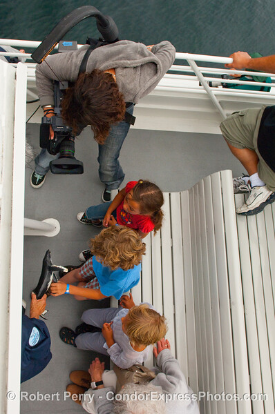 NOAA video camera person, Michelle Stevens, films young whalers.