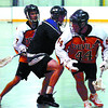 Shooter Pub Devil Jordan Zakerack, left, Cam Kilbreath, of the Little Caesar Assault, and #44 Blake McIntosh, battle for the ball in Wednesday night's playoff game at Kin 1. Citizen photo by David Mah.