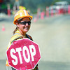 Charity Owen a flagperson with Guardian Angels Trafic Control keeps a smile on her face despite having to control trafic in the heat and dust on Pulpmill Road Wednesday morning at the Cameron Street Bridge project. Citizen photo by Brent Braaten
