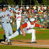 Yasmani Grandal of the USA National Team beats the ball to first base. Paul Wilson, of the host team Prince George Axemen was ready for the tag Wednesday night at the Prince George Stadium in Prince George. Citizen photo by David Mah
